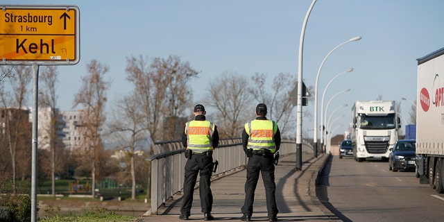 German police officers check vehicles at the German-France border in Kehl, Monday March 16, 2020. Germany partially closes its borders with France, Switzerland, Austria, Luxembourg and Denmark as it steps up efforts to stem the spread of the new coronavirus. For most people, the new coronavirus causes only mild or moderate symptoms. For some it can cause more severe illness. (AP Photo/Jean-Francois Badias)