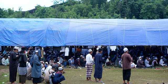 Muslim pilgrims gathered to pray on a field Thursday before the event was shut down. (AP)