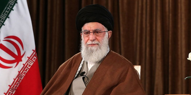 In this picture released by the official website of the office of the Iranian supreme leader, Supreme Leader Ayatollah Ali Khamenei sits prior to address nation on state television, in Tehran, Iran, Sunday, March 22, 2020. Iran's supreme leader Sunday refused U.S. assistance to fight the new coronavirus, citing an unfounded conspiracy theory that the virus could be man-made by America. (Office of the Iranian Supreme Leader via AP)