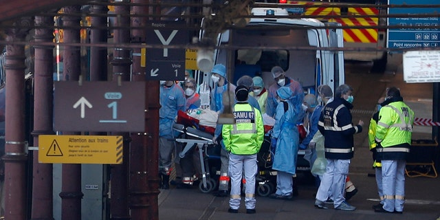 A patient is transferred in a high-speed train turned into an intensive care unit in Strasbourg on Thursday. (AP Photo/Jean-Francois Badias)