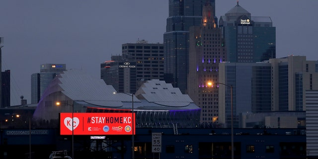 A sign downtown Kansas City, Missouri, urges residents to stay home on Tuesday, the first day of a 30-day mandatory stay-at-home order to stem the spread of the coronavirus. (AP Photo/Charlie Riedel)