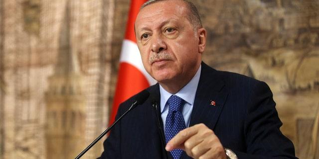 Turkey's President Recep Tayyip Erdogan speaks to his ruling party's lawmakers, in Istanbul, Saturday, Feb. 29, 2020. (Presidential Press Service via AP, Pool)