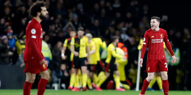 Liverpool's Andrew Robertson, right, and Liverpool's Mohamed Salah, left, react after Watford's Troy Deeney scores his side's third goal during the English Premier League soccer match between Watford and Liverpool at Vicarage Road stadium, in Watford, England, Saturday, Feb. 29, 2020. (AP Photo/Alastair Grant)