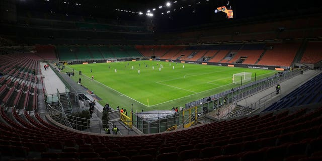 The seats are empty as a precaution against the coronavirus at the San Siro stadium in Milan, Italy, during the Europa League round of 32 second leg soccer match between Inter Milan and Ludogorets.