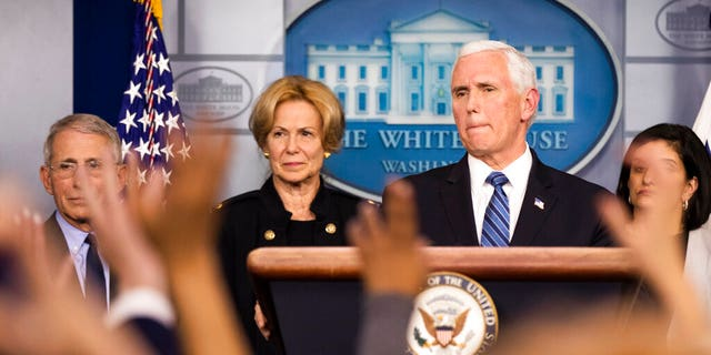 Vice President Mike Pence, with White House coronavirus response coordinator Dr. Deborah Birx second from left, and Director of the National Institute of Allergy and Infectious Diseases at the National Institutes of Health Anthony Fauci, left, and other members of President Donald Trump's coronavirus task force, speaks to reporters in the Brady press briefing room of the White House, Monday, March 2, 2020, in Washington. (AP Photo/Manuel Balce Ceneta)