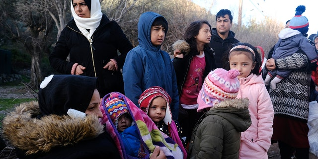 Migrants wait to leave from the village of Skala Sikaminias on the northeastern Aegean island of Lesbos, Greece, on Tuesday, March 3, 2020. Migrants and refugees hoping to enter Greece from Turkey appeared to be fanning out across a broader swathe of the roughly 200-kilometer-long land border Tuesday, maintaining pressure on the frontier after Ankara declared its borders with the European Union open. (AP Photo/Alexandros Michailidis)