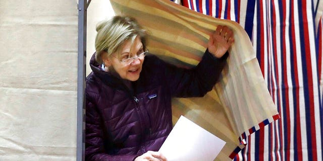 Democratic presidential candidate Sen. Elizabeth Warren, D-Mass., emerges from the booth with her ballot as she votes on Tuesday, March 3, 2020, in Cambridge, Mass. (AP Photo/Steven Senne)