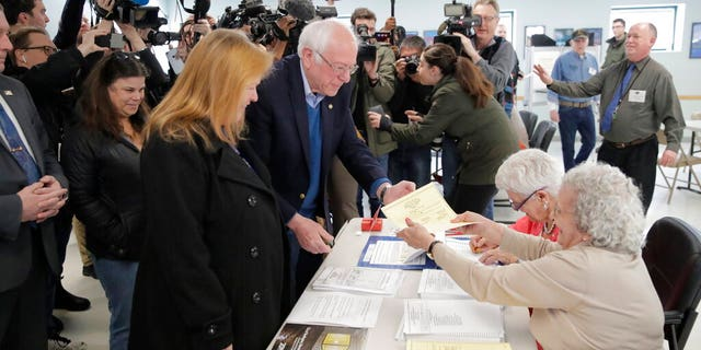 Democratic presidential candidate Sen. Bernie Sanders, I-Vt., arrives to vote in the Vermont Primary near his home in Burlington, Vt., Tuesday, March 3, 2020. (AP Photo/Charles Krupa)
