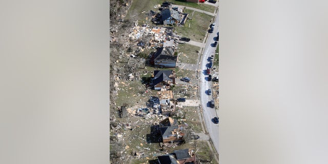 Destroyed homes line a street Tuesday, March 3, 2020, near Lebanon, Tenn. Tornadoes ripped across Tennessee early Tuesday, shredding more than 140 buildings and burying people in piles of rubble and wrecked basements. (AP Photo/Mark Humphrey)