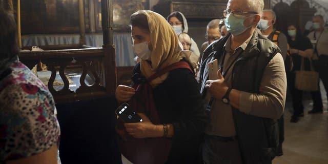 Palestinians confirms virus cases, declare two-week tourist ban
