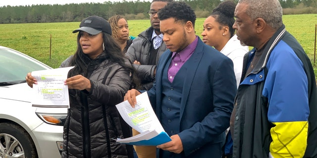Family members of condemned Alabama inmate Nathaniel Woods speak to reporters outside Holman Correctional Facility ahead of his scheduled execution on Thursday, March 5, 2020 in Atmore, Ala. (Associated Press)
