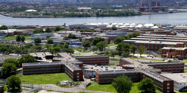 "FILE - In a June 20, 2014, file photo, the Rikers Island jail complex stands in New York with the Manhattan skyline in the background.<br data-cke-eol=""1""> (AP Photo/Seth Wenig, File)"