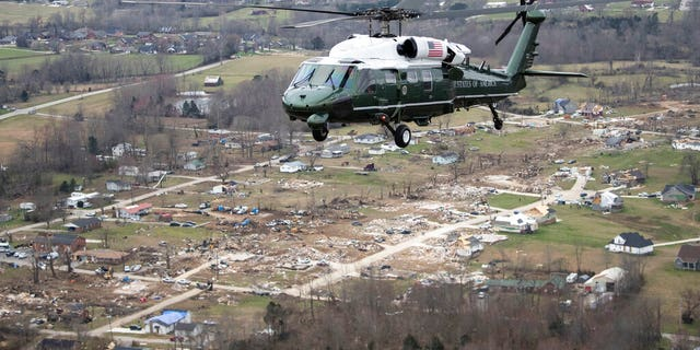 Marine One, with President Donald Trump aboard, left, flies over damage after a recent tornado, March 6, taken on the plane in flight over Cookeville, Tenn.