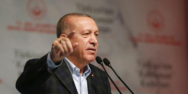 Turkey's President Recep Tayyip Erdogan speaks during a meeting marking the International Women's Day, in Istanbul, Sunday, March 8, 2020.