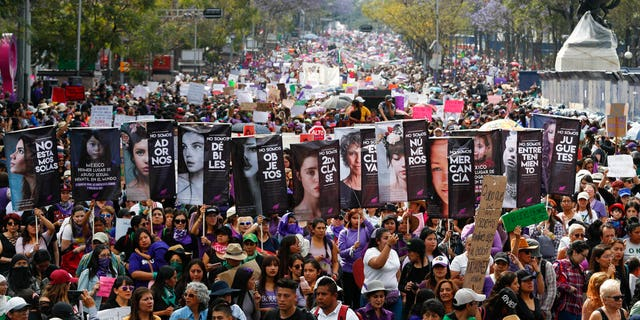 Women march during International Women's Day in Mexico City, Sunday, March 8, 2020.