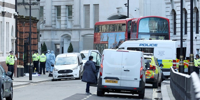 Police activity in Great Scotland Yard, in Whitehall, central London, near the area of an incident, in Whitehall, London, Monday, March 9, 2020. British police say they have shot dead a man who was brandishing two knives near Trafalgar Square in central London. The Metropolitan Police force said Monday that the shooting was not related to terrorism. (Yui Mok/PA via AP)