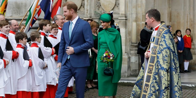 Britain's Harry and Meghan the Duke and Duchess of Sussex leave after attending the annual Commonwealth Day service at Westminster Abbey in London, Monday, March 9, 2020.