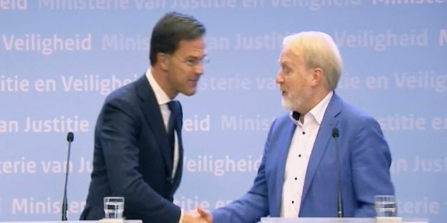 Netherlands' Prime Minister Mark Rutte called on citizens of the Netherlands to stop shaking hands to prevent spreading the new coronavirus and then shook hands with the head of the infectious diseases department of the national public health institute.