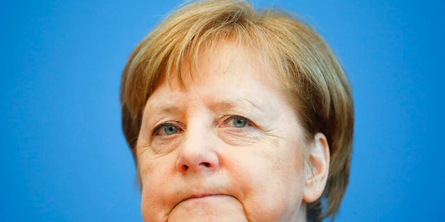German Chancellor Angela Merkel attends a news conference about the coronavirus outbreak in Germany, in Berlin, Germany, Wednesday, March 11, 2020.