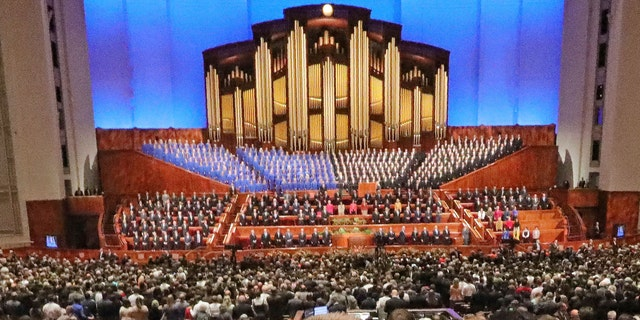 Conference goers listen during The Church of Jesus Christ of Latter-day Saints' twice-annual church conference in Salt Lake City, Oct. 5, 2019. (Associated Press)