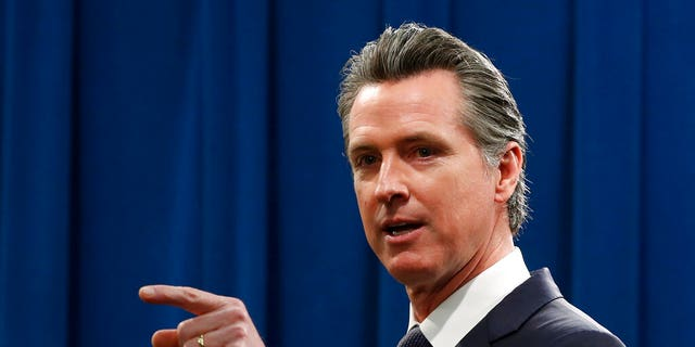California Gov. Gavin Newsom speaks to reporters about his executive order advising that non-essential gatherings of more than 250 people should be canceled until at least the end of March, during a news conference in Sacramento, Calif., Thursday, March 12, 2020.