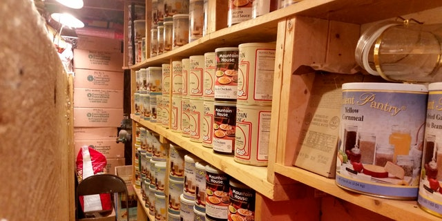In this undated photo provided by Paul Buescher, canned food rests on shelves in a barn near Garretsville, Ohio. The food can be used by 32 members of a group in northeastern Ohio that shares a farm packed with enough canned and dehydrated food and water to last for years. (Paul Buescher via AP)