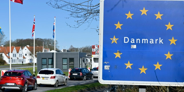 Cars drive north to the German-Danish border crossing near Flensburg, Germany, Saturady, March 14, 2020. Denmark closes its borders from noon in the Coronavirus crisis until further notice. (Carsten Rehder/dpa via AP)