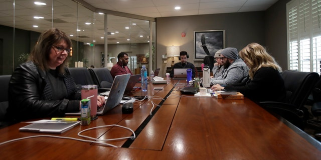 The Bay Church online pastoral team work on their computers during an online church service in Concord, Calif., Sunday, March 15, 2020. (AP Photo/Jeff Chiu)