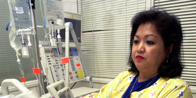 FILE: Lovely R. Suanino, a respiratory therapist at Newark Beth Israel Medical Center in Newark, N.J., demonstrates setting up a ventilator in the intensive care unit of the hospital.