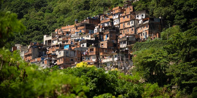 The Rocinha favela stands out from a hillside in Rio de Janeiro, Brazil, Monday, March 16, 2020. Rocinha, Brazil's largest favela, is home to about 70,000 people as of the latest census.