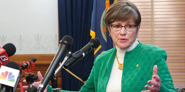 Kansas Gov. Laura Kelly answers questions from reporters after announcing that she'd order all public and private K-12 schools in the state to close for the rest of the semester, Tuesday, March 17, 2020, at the Statehouse in Topeka, Kan.