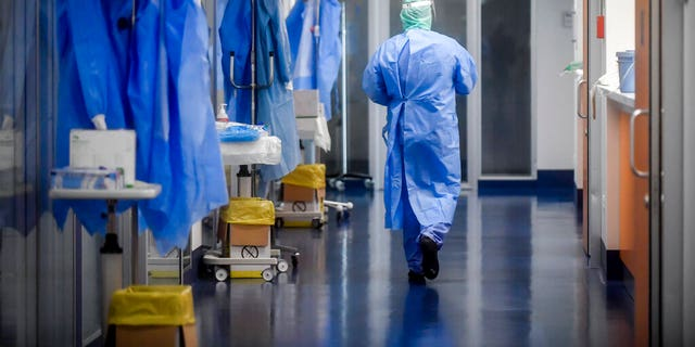 A view of the corridor outside the intensive care unit of the hospital of Brescia, Italy, Thursday, March 19, 2020.