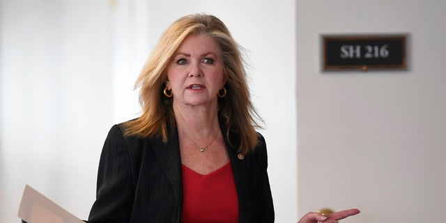 Sen. Marsha Blackburn, R-Tenn., heads into a Republican policy lunch on Capitol Hill in Washington on Thursday. Blackburn is pushing through legislation to decrease U.S. dependency on other countries for life-saving medication amid veiled threats from China to withhold coronavirus drugs. (AP Photo/Susan Walsh)