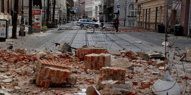 Police guard a street after an earthquake in Zagreb, Croatia, Sunday, March 22, 2020. A strong earthquake shook Croatia and its capital on Sunday, causing widespread damage and panic.(Associated Press)