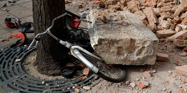 A bicycle is crushed by falling debris after an earthquake in Zagreb, Croatia, Sunday, March 22, 2020. A strong earthquake shook Croatia and its capital on Sunday, causing widespread damage and panic .(Associated Press)