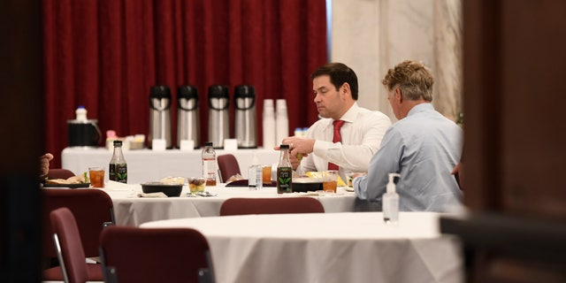 Sen. Rand Paul, R-Ky., right, sat near Sen. Marco Rubio, R-Fla., at a Republican policy lunch on Capitol Hill this past Friday, two days before Paul announced he tested positive for the coronavirus. (AP Photo/Susan Walsh)
