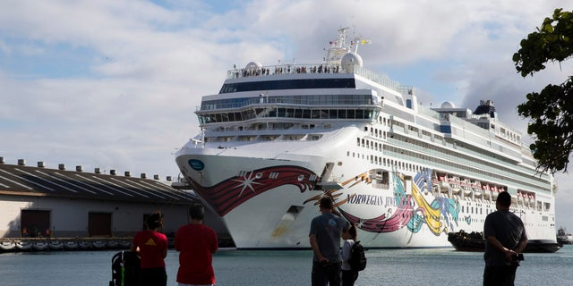 The Norwegian Jewel cruise ship docks at Honolulu Harbor on March 22. The cruise ship that had to cut short its trip because of the new coronavirus and mechanical problems docked Sunday in Honolulu's harbor. (Cindy Ellen Russell/Honolulu Star-Advertiser via AP)