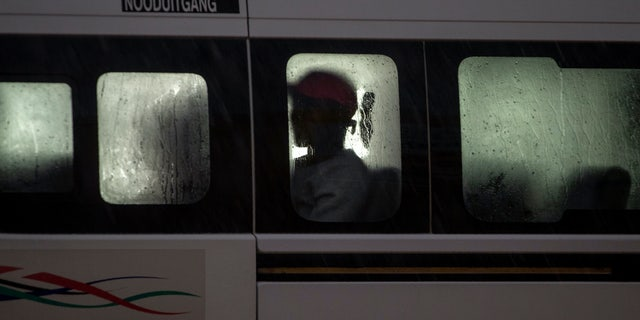 A passenger sits inside a mini-bus taxi in Tembisa, east of Johannesburg, South Africa, Monday, March 23, 2020. South Africa, Africa's most industralized economy and a nation of 57 million people, will to go into a nationwide lockdown for 21 days from Thursday to fight the spread of the new coronavirus. (AP Photo/Themba Hadebe)