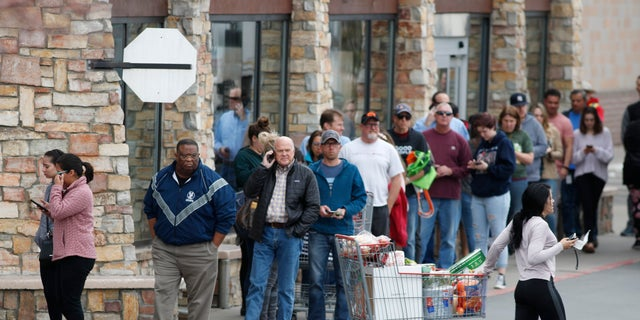 One shopper pulls her cart out of a Costco warehouse in Lone Tree, Colo. (AP Photo/David Zalubowski)