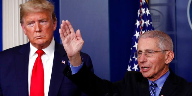 President Trump with Dr. Anthony Fauci, the director of the National Institute of Allergy and Infectious Diseases, during a briefing at the White House on Tuesday. (AP Photo/Alex Brandon)