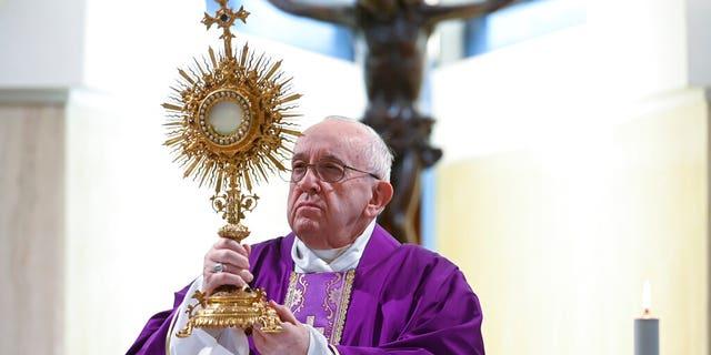 Pope Francis celebrates Mass at his Santa Marta residence, at the Vatican, Thursday, March 26, 2020.