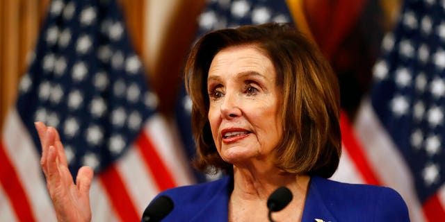 House Speaker Nancy Pelosi, D-Calif., speaks before she signs the Coronavirus Aid, Relief, and Economic Security (CARES) Act after it passed in the House on Capitol Hill, Friday, March 27, 2020. (AP Photo/Andrew Harnik)