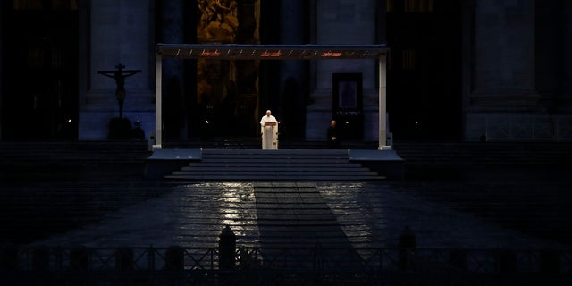 """Pope Francis delivers the Urbi and Orbi prayer (Latin for To the City and To the World) in an empty St. Peter's Square, at the Vatican on Friday. Praying in a desolately empty St. Peter's Square, Pope Francis on Friday likened the coronavirus pandemic to a storm laying bare illusions that people can be self-sufficient and instead finds """"all of us fragile and disoriented"""" and needing each other's help and comfort. (AP Photo/Alessandra Tarantino)"""