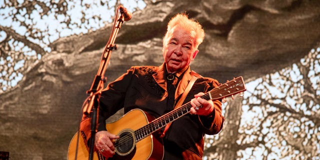 This June 15, 2019, file photo shows John Prine performing at the Bonnaroo Music and Arts Festival in Manchester, Tenn.