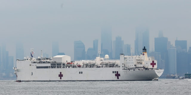 The Navy hospital ship USNS Comfort arrives in New York City to help provide relief for the coronavirus outbreak that is impacting the area's hospitals. (AP)