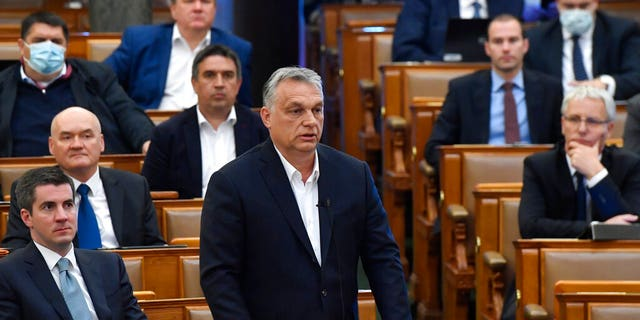 Hungarian Prime Minister Viktor Orban replies to faction leader of the oppositional Jobbik party Peter Jakab during a question and answer session of the Parliament in Budapest, Hungary, Monday, March 30, 2020.