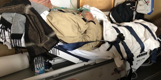 Amer Fakhoury resting on stretcher on his way home to the U.S. Courtesy of the Fakhoury family.