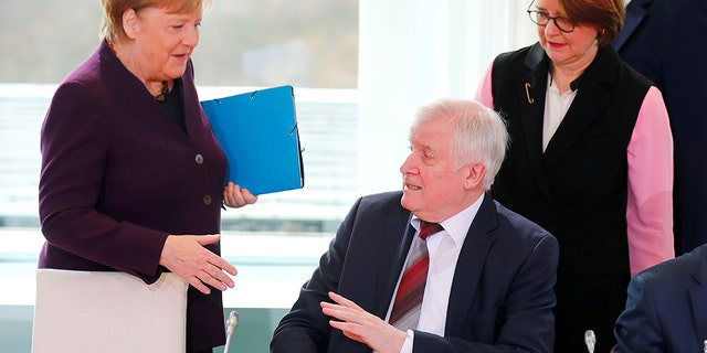 German Interior Minister Horst Seehofer refuses to shake the hand of German Chancellor Angela Merkel for hygienic reasons before a migration summit at the Chancellery in Berlin, Germany, March 2, 2020. REUTERS/Hannibal Hanschke TPX IMAGES OF THE DAY - RC2MBF9K74K1