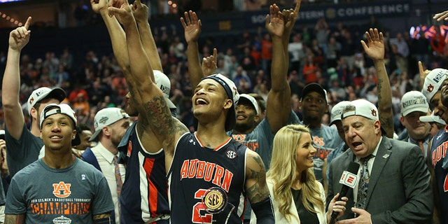 The Auburn Tigers team after winning the Southeastern Conference Tournament championship game between the Tennessee Volunteers and Auburn Tigers, March 17, 2019, at Bridgestone Arena in Nashville, Tennessee. (Photo by Matthew Maxey/Icon Sportswire via Getty Images)