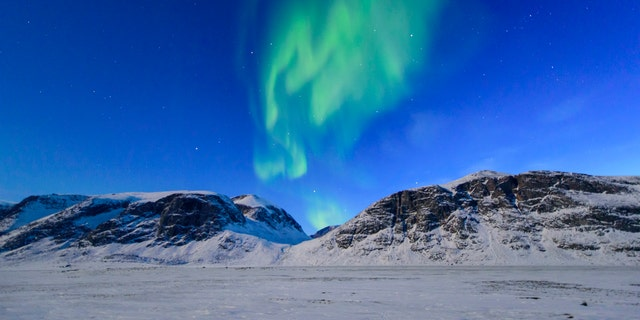 Northern lights over the frozen landscape of Akshayuk Pass, in Auyuittuq National Park on April 8, 2017 on Baffin Island, Canada. -file photo.